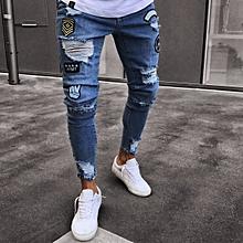 Men Feet Badge Jeans Men  039 s Trends Knee Hole Zipper Feet Hole Denim 94136f5afb9